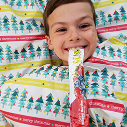 boy smiling healthy snack food bed UGC branded content