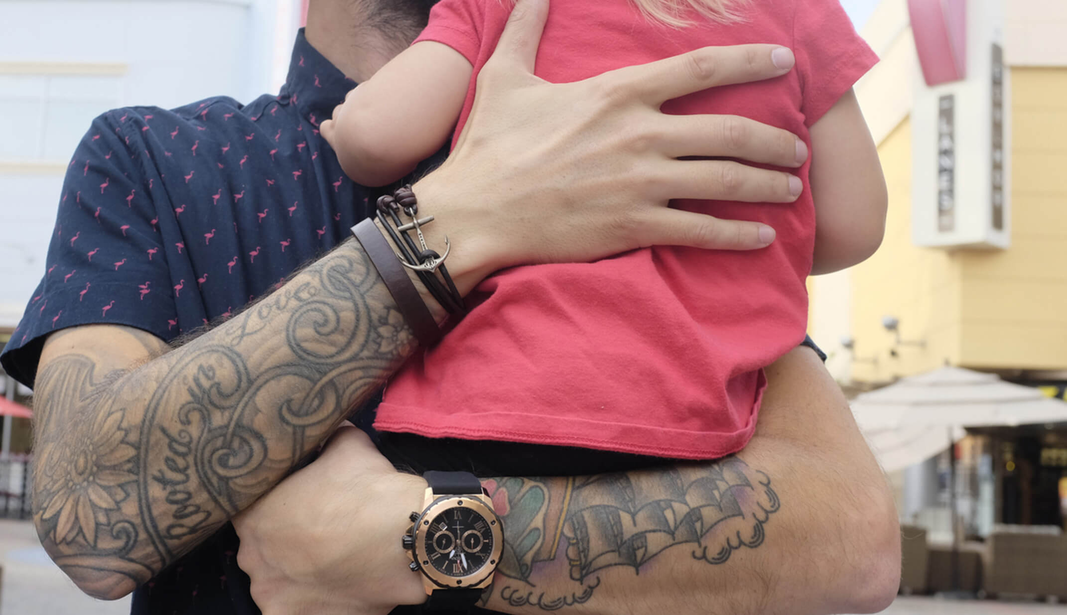 hipster father holding daughter watch hand tattoos shirt town portrait street men family love hug hands freelance bulova UGC content