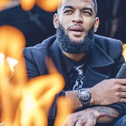 handsome Afro-American man fashion watch beard portrait UGC content tie fall black orange