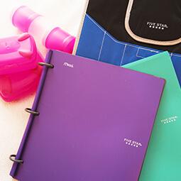 binders purple green flay-lay homework ping girl branded UGC content