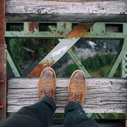 shoes looking down urban architecture old wood retro forest street photography travel UGC content